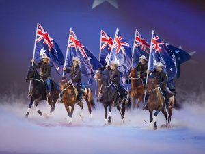 australian permanent residents on horses with australia flags in hands